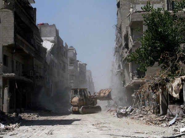 तीन साल में दो लाख मौतें और घोस्ट टाउन में तब्दील हुआ सीरिया